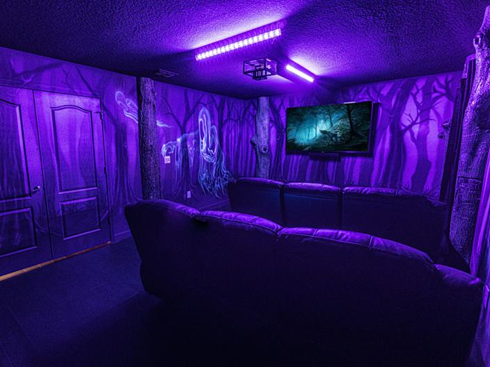 The theater can be lit with black lights.
