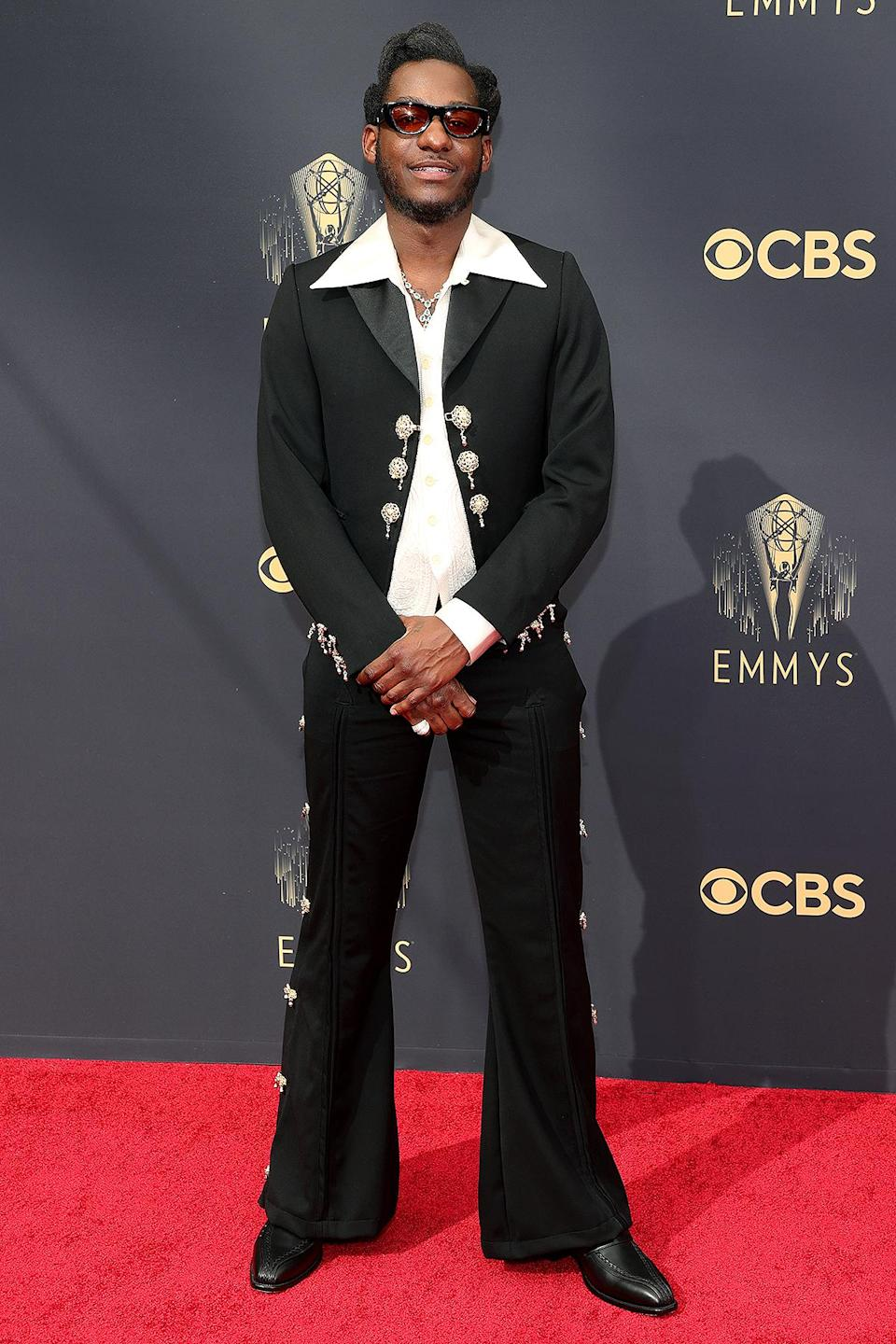 <p>Leon Bridges looked like a '70s dream in his black bell-bottom suit, complete with silver tassels and buttons. </p>