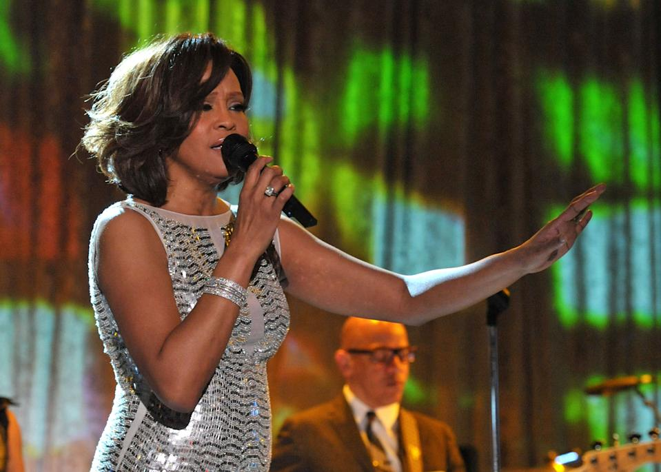 Whitney Houston performs onstage at the 2011 Pre-GRAMMY Gala and Salute To Industry Icons on February 12, 2011. (Photo by Lester Cohen/WireImage)