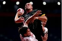 <p>Paul Drux of Germany attempts to shoot against while being Magnus Abelvik Roed and Magnus Gullerud of Norway during the men's preliminary round handball match.</p>
