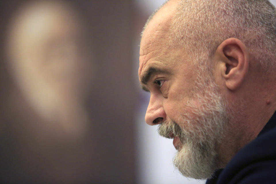 Albanian Prime Minister Edi Rama, listens a question during an interview with the Associated Press, in Tirana, Albania , on Tuesday, April 20, 2021. Albania holds parliamentary elections on Sunday, April 25. (AP Photo/Hektor Pustina)