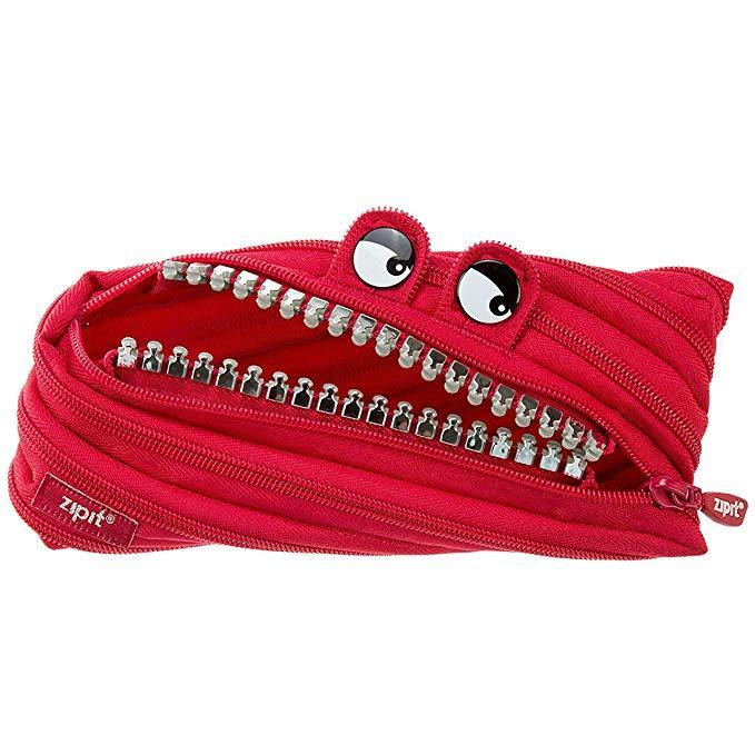 """This hungry dude will swallow all of your pens, pencils, and other assorted desk clutter alive!<br><br><strong>ZIPIT</strong> Grillz Pencil Case, $, available at <a href=""""https://www.amazon.com/dp/B005ZERJ9Q/ref=twister_B07K8BQ8MD"""" rel=""""nofollow noopener"""" target=""""_blank"""" data-ylk=""""slk:Amazon"""" class=""""link rapid-noclick-resp"""">Amazon</a>"""