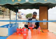 A street vendor sells juice along a street in Fnideq, close to the Spanish enclave Ceuta