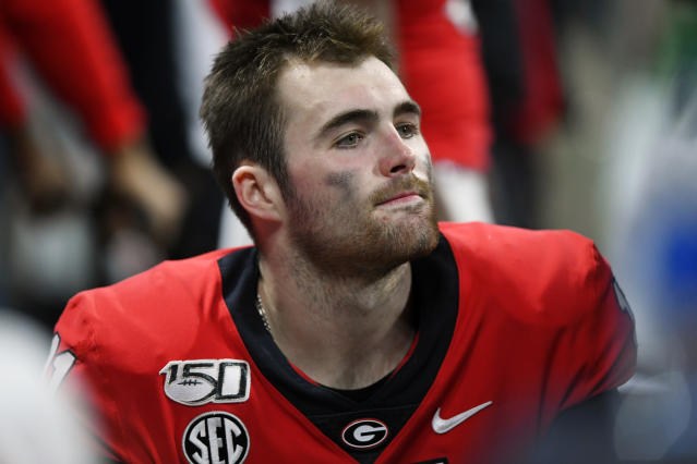 Georgia quarterback Jake Fromm sits on the bench after the Southeastern Conference championship NCAA college football game against LSU, Saturday, Dec. 7, 2019, in Atlanta. LSU won 37-10. (AP Photo/John Amis)