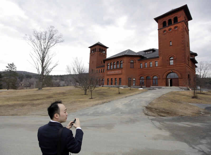 FILE - In this March 8, 2012 file photo, Christopher Chou, chief of staff at the World Evangelical Alliance, makes a picture of the auditorium on the 217-acre campus that once housed the Northfield Mount Herman prep school in Northfield, Mass. The owners of the 217-acre campus in the hills of western Massachusetts announced Friday, Sept. 21, 2012 that they will give it away to Grand Canyon University in Arizona, the first for-profit Christian school in the country. (AP Photo/Elise Amendola, File)