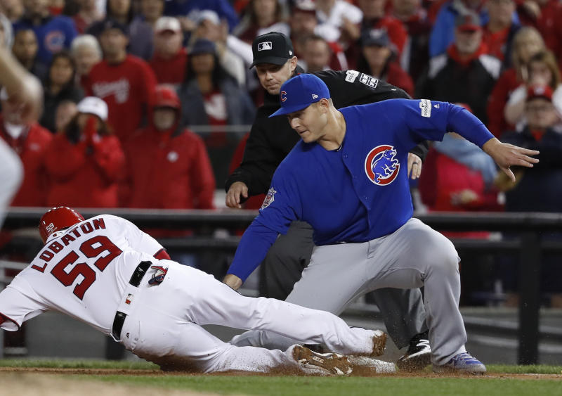 Chicago Cubs first baseman Anthony Rizzo picks off Washington Nationals' Jose Lobaton in Game 5 of baseball's National League Division Series against the Chicago Cubs. (AP)