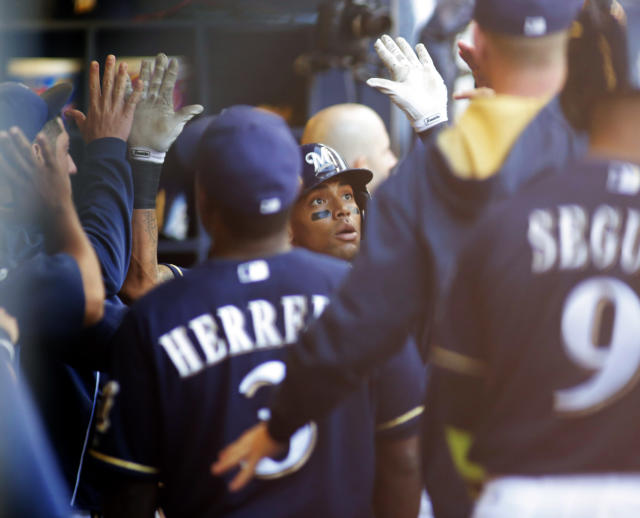 Milwaukee Brewers' Khris Davis, center, is congratulated by team mates after hitting a two run home run against the Los Angeles Dodgers during the second inning of a baseball game Saturday, Aug. 9, 2014, in Milwaukee. (AP Photo/Darren Hauck)
