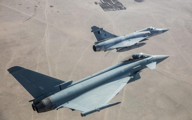 An RAF Typhoon flies in formation with one of Qatar's current jets  - Anadolu