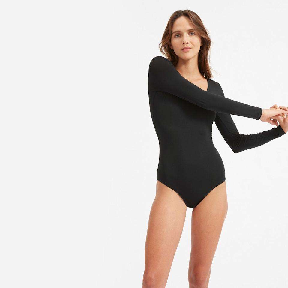 """<h3><a href=""""https://www.everlane.com/products/womens-ls-v-neck-bodysuit-black"""" rel=""""nofollow noopener"""" target=""""_blank"""" data-ylk=""""slk:Everlane The Long-Sleeve V-Neck Bodysuit"""" class=""""link rapid-noclick-resp"""">Everlane The Long-Sleeve V-Neck Bodysuit</a></h3><br>After covering <a href=""""https://refinery29.com/en-us/2020/02/9448661/everlane-sold-out-bodysuits"""" rel=""""nofollow noopener"""" target=""""_blank"""" data-ylk=""""slk:the awaited return of the brand's beloved long-sleeved bodysuits"""" class=""""link rapid-noclick-resp"""">the awaited return of the brand's beloved long-sleeved bodysuits</a> that sold out within two weeks' time, our readers were chomping at their add-to-carts. And we can see why: the form-fitting and figure-flattering classic is an effortless winter layering essential. <br><br><strong>Everlane</strong> The Long-Sleeve V-Neck Bodysuit (Black), $, available at <a href=""""https://www.everlane.com/products/womens-ls-v-neck-bodysuit-black"""" rel=""""nofollow noopener"""" target=""""_blank"""" data-ylk=""""slk:Everlane"""" class=""""link rapid-noclick-resp"""">Everlane</a>"""