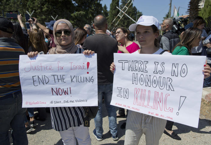 Two Palestinian women hold placards during a rally in front of the Prime Minister's office, in the West Bank city of Ramallah, Monday, Sept. 2. 2019. Hundreds of Palestinian women protested in front of the prime minister's office to demand an investigation into the death of Israa Ghrayeb, a 21-year-old woman whom many suspect was the victim of a so-called honor killing. (AP Photo/Nasser Nasser)