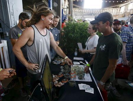 """Vendors and marijuana enthusiasts gather at a """"Weed the People"""" event to celebrate the legalization of recreational use of marijuana in Portland, Oregon July 3, 2015. REUTERS/Steve Dipaola"""