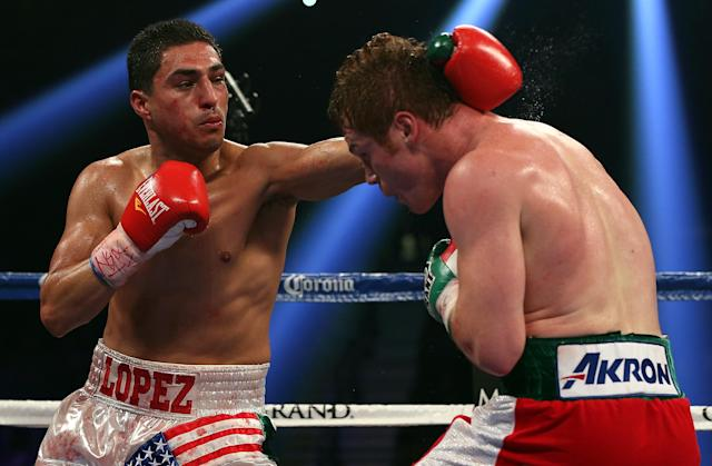 LAS VEGAS, NV - SEPTEMBER 15: Josesito Lopez lands a left to the head of Canelo Alvarez during their WBC super welterweight title fight at MGM Grand Garden Arena on September 15, 2012 in Las Vegas, Nevada. (Photo by Josh Hedges/Getty Images)