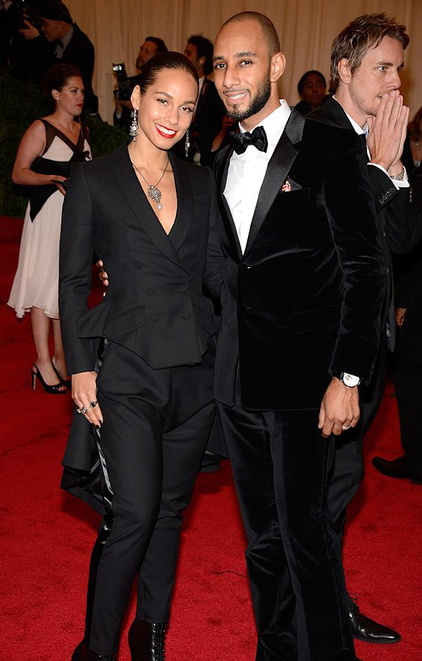 "<p class=""MsoNoSpacing"">Married duo Alicia Keys and producer Swizz Beatz looked near-identical in matching black suits – except he accessorized with a bow tie; she with a pendant necklace.</p>"