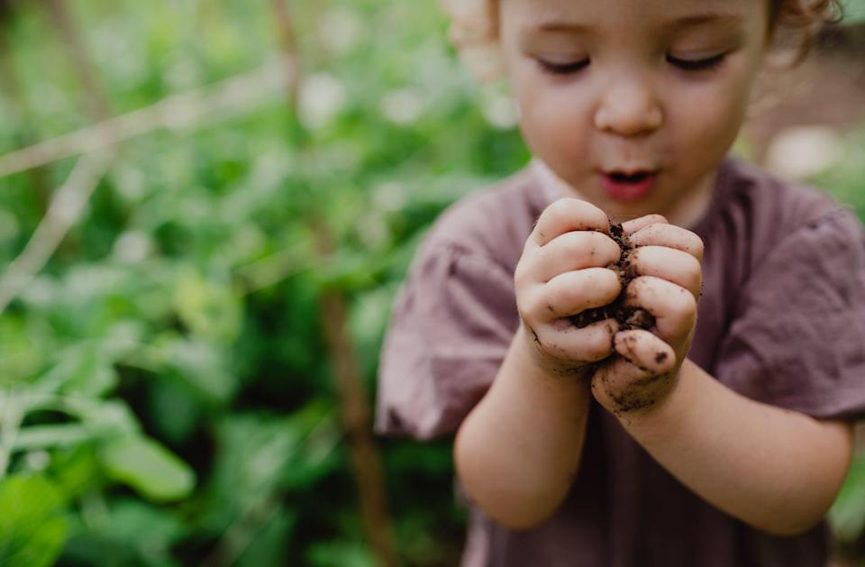 """<p>Gardening is a great activity that fosters creativity, fine and gross motor skills, as well as communication skills. If you have <a href=""""https://www.popsugar.com/family/Gardening-Kits-Kids-28734703"""" class=""""link rapid-noclick-resp"""" rel=""""nofollow noopener"""" target=""""_blank"""" data-ylk=""""slk:children's gardening tools"""">children's gardening tools</a>, take them out into the yard, and find a place where you feel comfortable allowing your child to explore. This means showing them that they can dig, move dirt around, add water, create dirt art, plant if you have anything that needs planting, and otherwise notice the sounds, sights, and textures around them. If they take an interest in anything, like a bug or a bird, go investigate it with them. If you don't have gardening tools, you can use Tupperware and your child's utensils to explore your garden with. If you don't have a yard, you can create your own mini version of this tactile exercise with a small planter box or container, soil, and some water.</p>"""