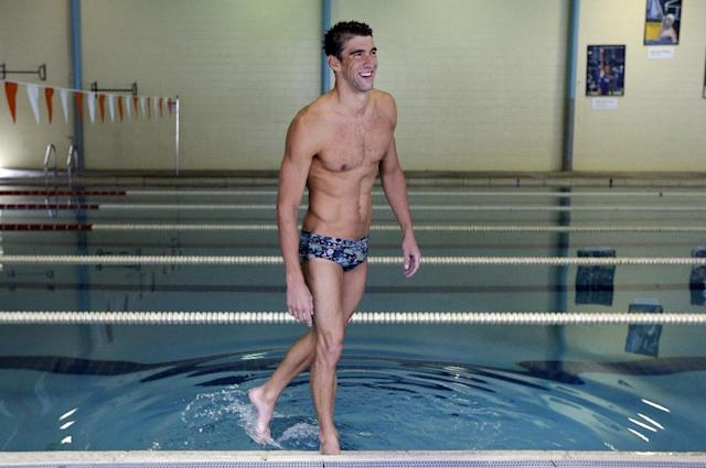 In this July 31, 2014 photo, Michael Phelps washes off his feet after swimming at Meadowbrook Aquatic and Fitness Center in Baltimore. This is where Phelps put in most of the work to become the most decorated athlete in Olympic history. This is where he's looking to add to that legacy after an aborted retirement, his eyes firmly on the Rio Games two years away. (AP Photo/Patrick Semansky)