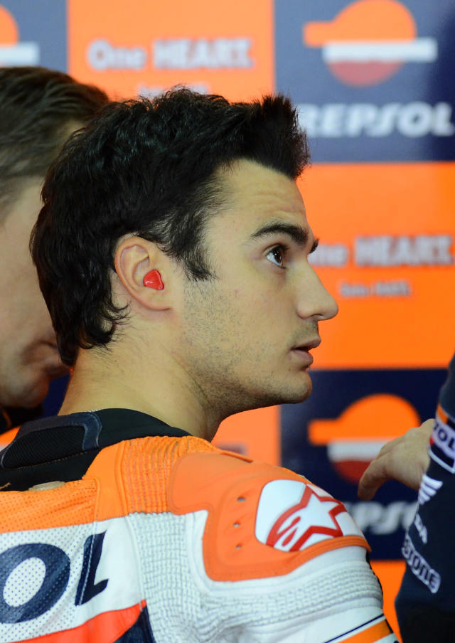 Repsol Honda Team Spanish rider Dani Pedrosa looks on during the Moto GP qualifying practice session at Motorland's race track in Alcaniz on September 29, 2012. AFP PHOTO/ PIERRE-PHILIPPE MARCOUPIERRE-PHILIPPE MARCOU/AFP/GettyImages