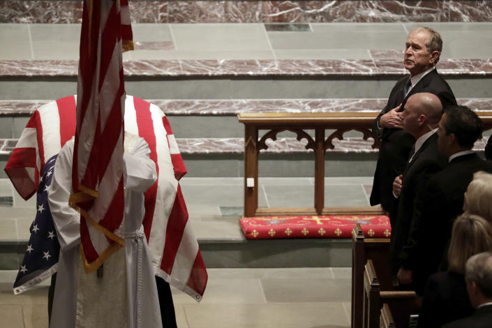 Former President George W. Bush places a hand on his chest during a funeral for former President George H.W. Bush at St. Martin's Episcopal Church Thursday, Dec. 6, 2018, in Houston. (Photo: Mark Humphrey/AP)