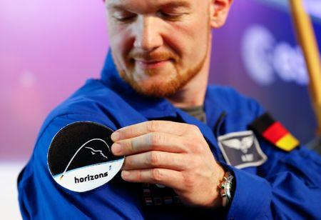 German astronaut Gerst presents the name and logo of his next ISS mission during a news conference at the EAC in Cologne