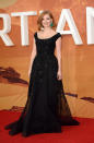 <p>While Kristen Wiig and Kate Mara were more dressed for a gray affair (in between black tie and casual), Jessica Chastain went all out for the London premiere of her new film. In an Elie Saab couture gown, the black piece was covered in bling and then she wore a pair of large emerald earrings that surely look painful but the smile on her face makes it all seem worth it. </p>