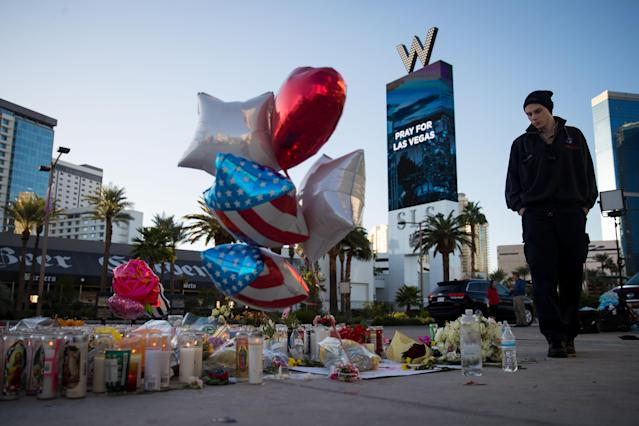 <p>Matthew Helms, who worked as a medic the night of the shooting, visits a makeshift memorial for the victims of Sunday night's mass shooting, on the north end of the Las Vegas Strip, October 3, 2017 in Las Vegas, Nevada. (Photo: Drew Angerer/Getty Images) </p>