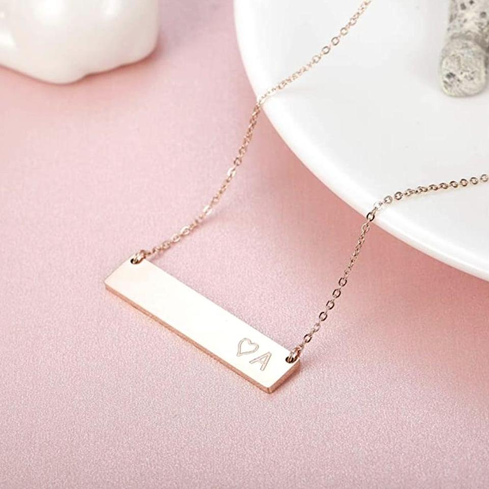<p>We love the little heart detail on this <span>Finrezio Rose Gold Plated Stainless Steel Initial Heart Bar Necklace</span> ($15).</p>