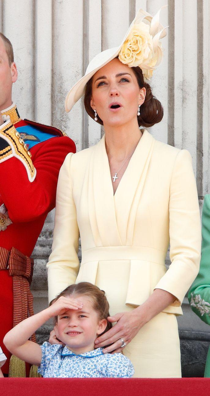 <p>The Duchess of Cambridge styled her Alexander McQueen yellow dress (cut in a silhouette just like Tiana's!) to be more formal, pairing it with a matching fascinator by Philip Treacy. </p>