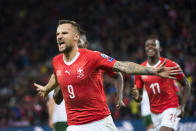 Switzerland's forward Haris Seferovic, celebrates after scoring the first goal of the game against Republic of Ireland, during their Euro 2020 qualifying Group D soccer match at the Stade de Geneve, in Geneva, Switzerland, Tuesday, Oct. 15, 2019. (Jean-Christophe Bott/Keystone via AP)