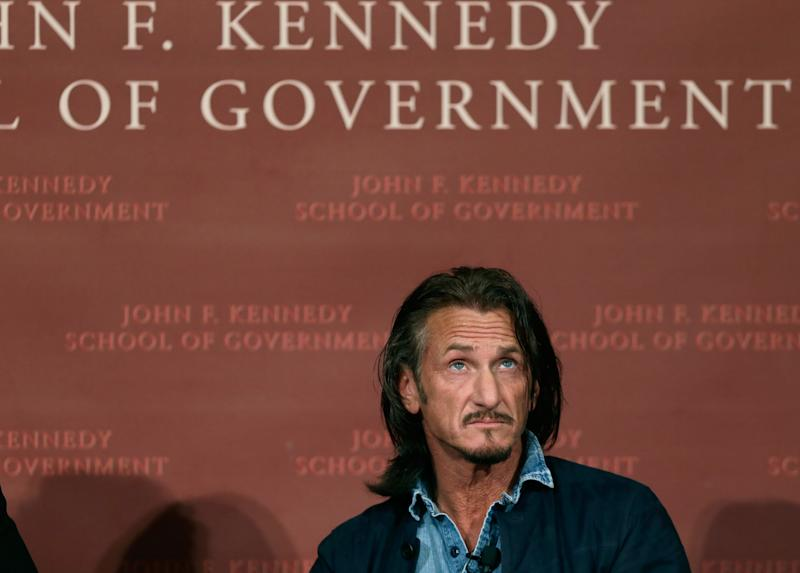 Actor-director Sean Penn listens as he participates in a discussion at Harvard University's John F. Kennedy School of Government in Cambridge, Mass. Tuesday, Feb. 26, 2013 regarding Haiti in the wake of a devastating earthquake three years ago. Penn is the co-founder of the J/P Haitian Relief Organization. (AP Photo/Elise Amendola)