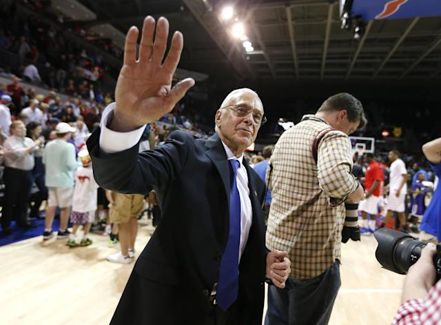 SMU head coach Larry Brown waves to the crowd after winning an NCAA college basketball game against UC Irvine in the first round of the NIT Wednesday, March 19, 2014, in Dallas. SMU won 68-54. (AP Photo/Sharon Ellman)