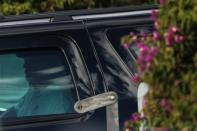 U.S. President Donald Trump is seen inside of his armored vehicle in the presidential motorcade while leaving his Mar-a-Lago resort in Palm Beach