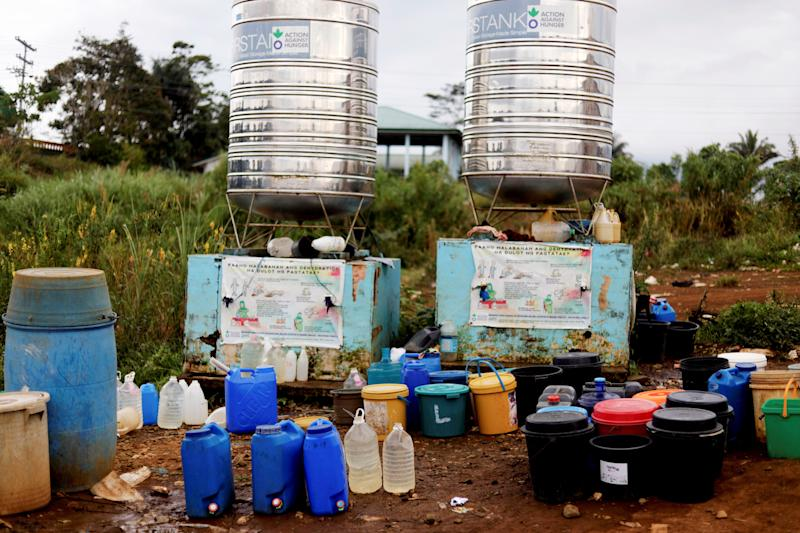 Containers are lined up beside a water tank at an evacuation camp in Marawi City, Lanao del Sur province, Philippines. (Photo: Eloisa Lopez/Reuters)