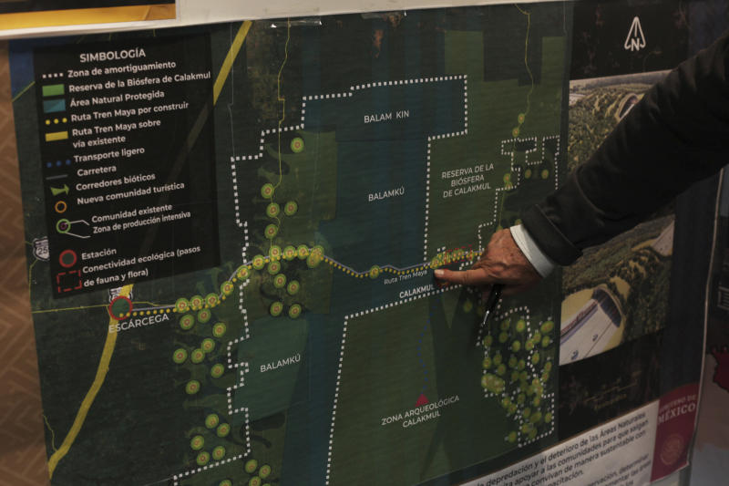 Rogelio Jiménez Pons, director of Fonatur, points to a map of a planned train line through the Yucatan Peninsula, during an interview in Mexico City, Monday, March 18, 2019. The Mayan Train would circle the Yucatan Peninsula, serving tourists and workers at Cancun and the glistening resorts of the Riviera Maya, but also haul cargo. (AP Photo/Marco Ugarte)