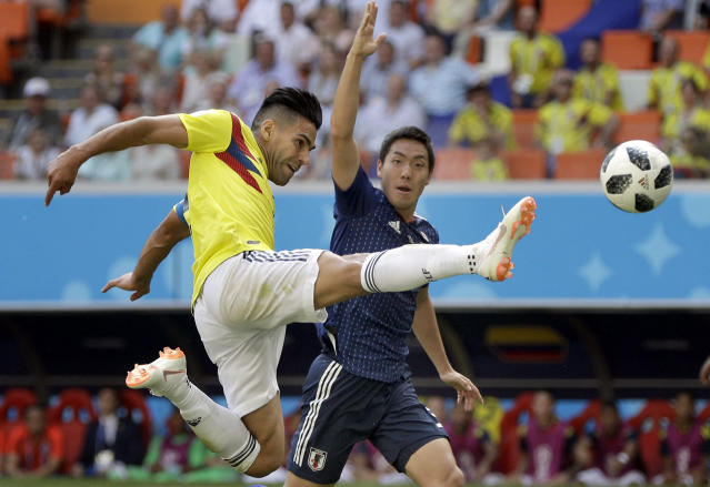Colombia's Radamel Falcao, left, plays the ball during the group H match between Colombia and Japan at the 2018 soccer World Cup in the Mordavia Arena in Saransk, Russia, Tuesday, June 19, 2018. (AP Photo/Mark Baker)