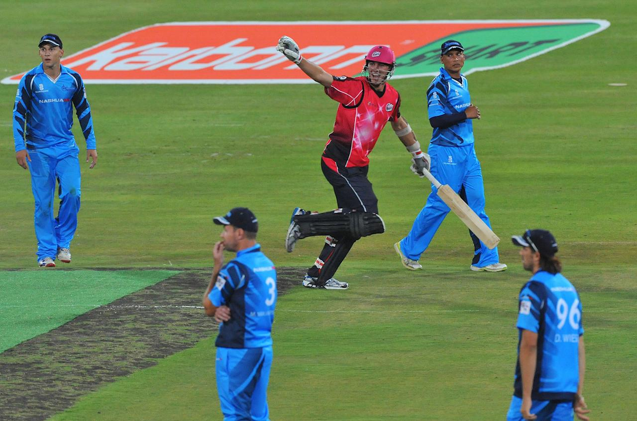PRETORIA, SOUTH AFRICA - OCTOBER 26: (SOUTH AFRICA OUT) Pat Cummins of the Sixers celebrates after running the single needed for victory during the Karbonn Smart CLT20 Semi Final match between Nashua Titans and Sydney Sixers at SuperSport Park on October 26, 2012 in Pretoria, South Africa. (Photo by Duif du Toit/Gallo Images/Getty Images)