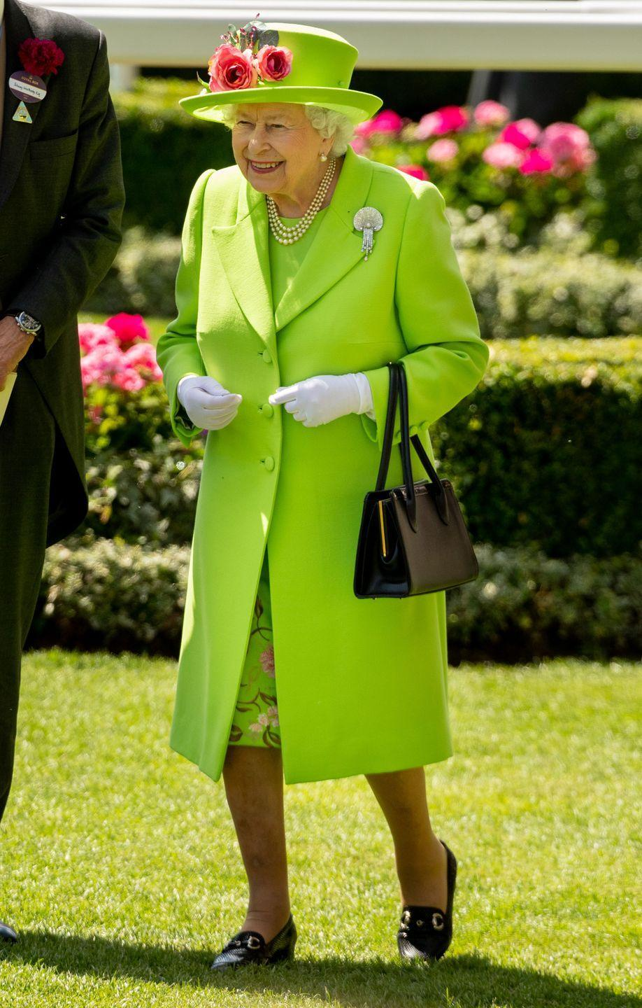 <p>Queen Elizabeth is also known for her bright ensembles. The neon green hat, jacket and dress that she wore to the Royal Ascot in 2018 reminds us of the shade Peter Pan's pal, Tinker Bell, is known for wearing.</p>