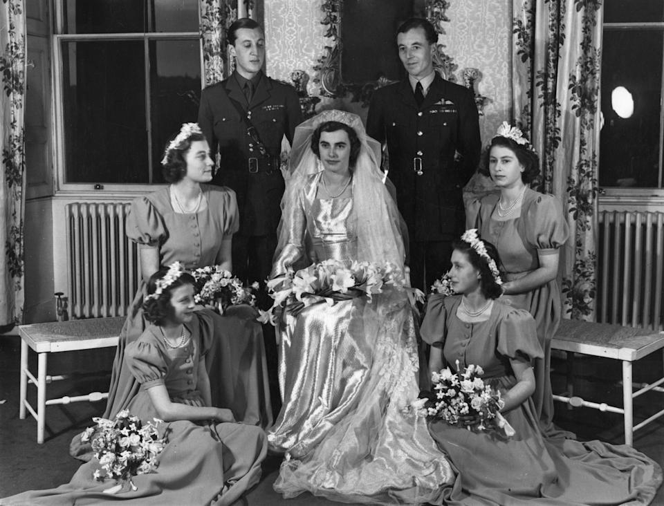 The wedding group at the reception held at Broadlands, the Mountbatten home, shows the bride, Hon. Patricia Mountbatten; and groom, Lord Brabourne; the best man, Squadron leader Charles Harris St. John; and the four bridesmaids, Princess Elizabeth (centre right); Princess Margaret (lower right); Princess Alexandra (lower left); and the Hon. Pamela Mountbatten, sister of the bride.   (Photo by PA Images via Getty Images)