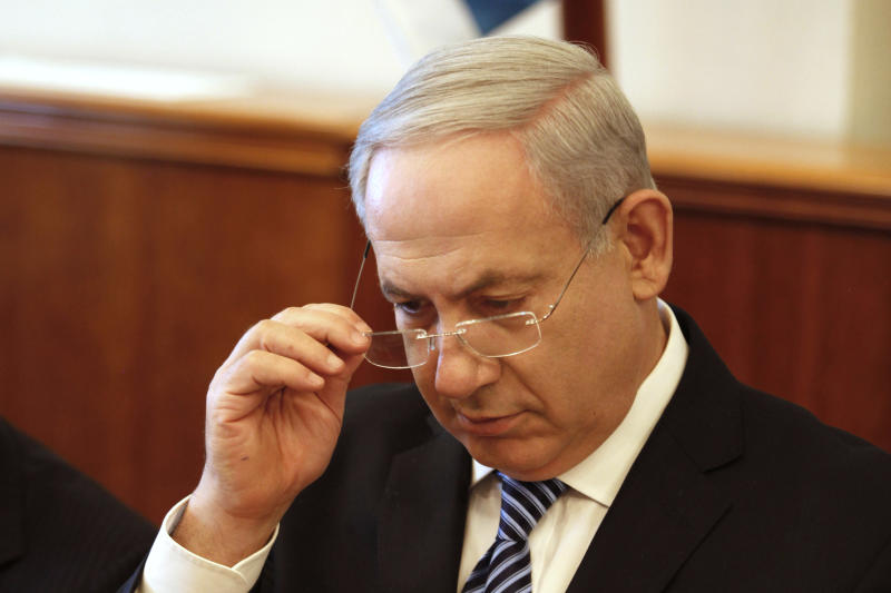 Israeli Prime Minister Benjamin Netanyahu opens the weekly cabinet meeting at his office in Jerusalem, Sunday, July 22, 2012. The Israeli government is asking the country's Supreme Court to delay the evacuation of an unauthorized West Bank settlement outpost by a month. The court has ordered the Migron outpost dismantled by Aug. 1, 2012. (AP Photo/Gali Tbbon, Pool)