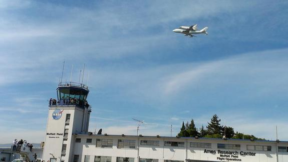 Space shuttle Endavour and its Shuttle Carrier Aircraft fly over NASA's Ames Research Center control tower at Moffett Field, Calif., during a state-wide tour on Sept. 21, 2012. Endeavour flew over many California cities on the way to Los Angele