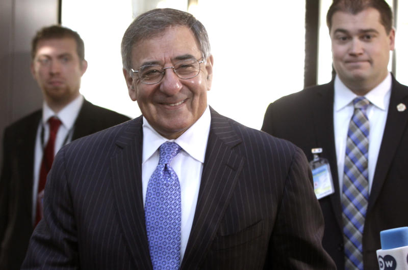 United States Secretary of Defense Leon Panetta, center, arrives for a meeting of NATO Defense Ministers at NATO headquarters in Brussels on Tuesday, Oct. 9, 2012. NATO defense leaders gathering for a two-day meeting in Brussels, are committed to the war in Afghanistan, according to U.S. and alliance officials, but there are growing signs that the Afghan political and military hostilities against the coalition are starting to wear on the coalition. (AP Photo/Virginia Mayo)
