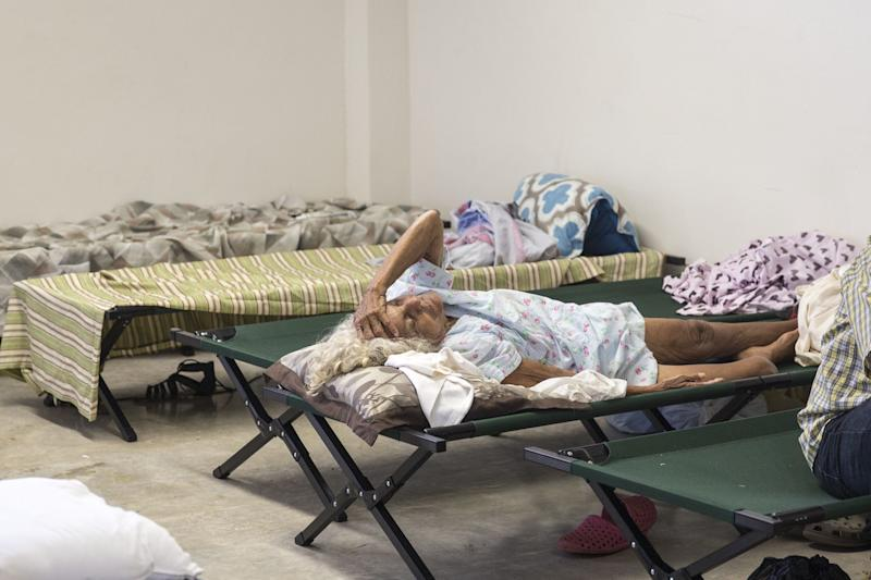 A resident lay on a cot inside a shelter after being evacuated from a home near the damaged Guajataca Dam after Hurricane Maria in Isabella, Puerto Rico, on Saturday, Sept. 23, 2017. Amid their struggles to recover from�Hurricane�Maria, some Puerto Rico residents found it befuddling that President Donald Trump fired off a number of Twitter rants about professional athletes on Saturday -- yet made no mention of their dire situation. Photographer: Alex Wroblewski/Bloomberg via Getty Images