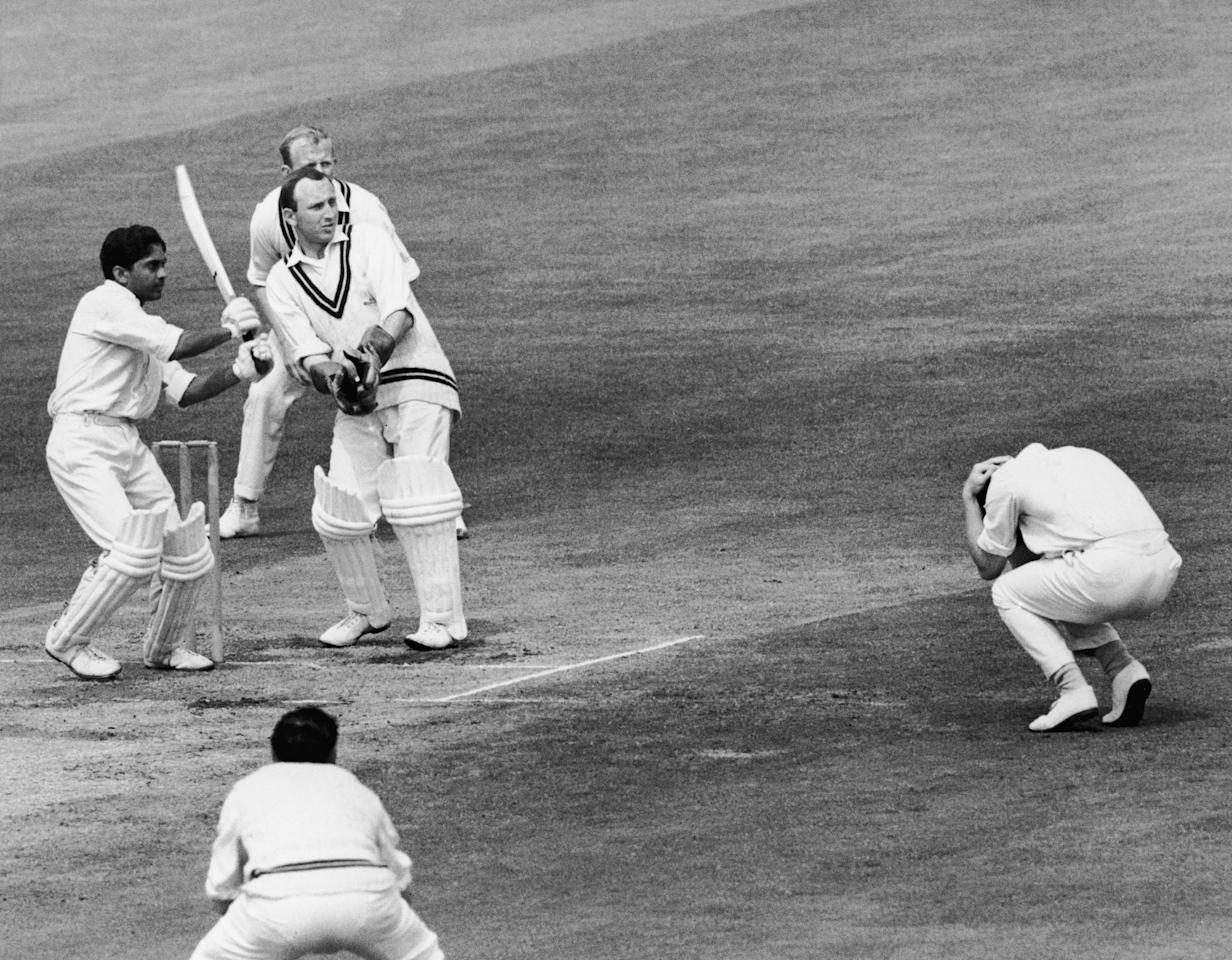A fieldsman cowers before a ball from Hanumant Singh (1939 - 2006) during a match between India and Surrey at the Oval, 2nd June 1967. The wicket-keeper is Arnold Long and behind him is Stewart Storey. (Photo by Leonard Burt/Central Press/Hulton Archive/Getty Images)