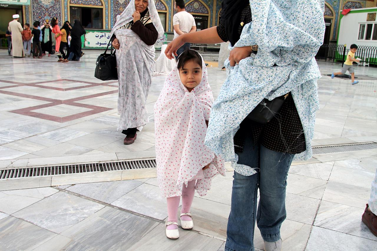 <p>A Shiite Muslim girl arrives at Imamzadeh Saleh mosque in Tajrish Square in northern Tehran on May 30, 2017, during the holy fasting month of Ramadan. (Atta Kenare/AFP/Getty Images) </p>