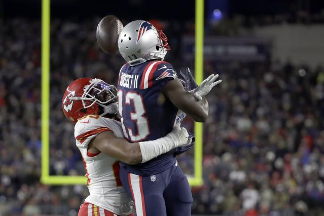 Kansas City Chiefs cornerback Kendall Fuller, left, breaks up a pass intended for New England Patriots wide receiver Phillip Dorsett in the second half of an NFL football game, Sunday, Dec. 8, 2019, in Foxborough, Mass. (AP Photo/Elise Amendola)