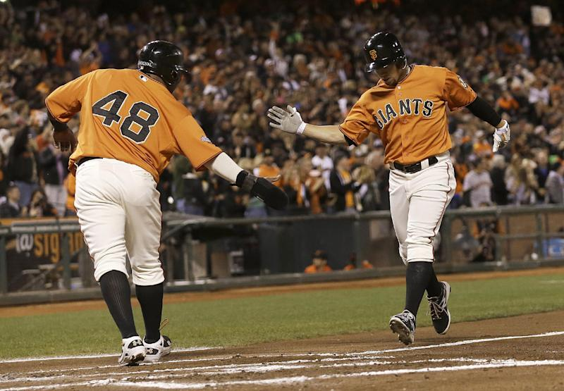 San Francisco Giants' Juan Perez, right, celebrates with Pablo Sandoval (48) after hitting a two-run home run off of San Diego Padres pitcher Burch Smith to score Sandoval during the second inning of a baseball game in San Francisco, Friday, Sept. 27, 2013. (AP Photo/Jeff Chiu)