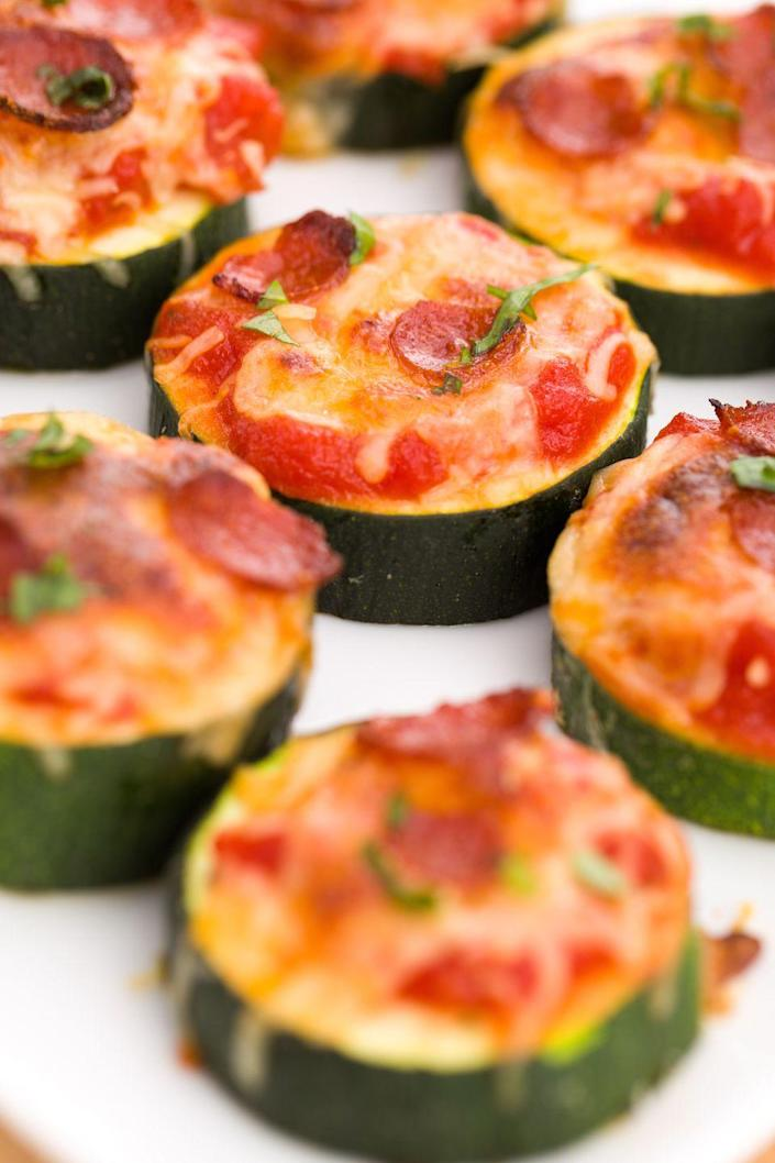 """<p>Eating healthy should never mean giving up pizza.</p><p>Get the recipe from <a href=""""https://www.delish.com/cooking/recipe-ideas/recipes/a43638/mini-zucchini-pizzas-recipe/"""" rel=""""nofollow noopener"""" target=""""_blank"""" data-ylk=""""slk:Delish"""" class=""""link rapid-noclick-resp"""">Delish</a>.</p>"""