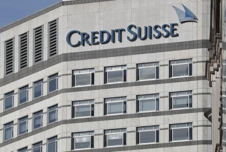 The Credit Suisse logo is seen at their offices at Canary Wharf financial district in London
