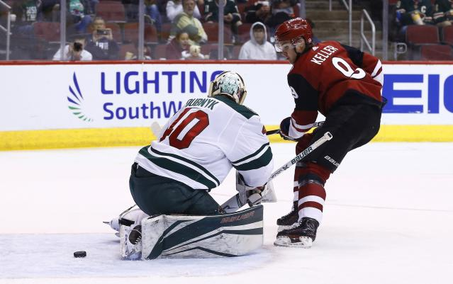 Arizona Coyotes center Clayton Keller, right, beats Minnesota Wild goaltender Devan Dubnyk, left, for a goal during the second period of an NHL hockey game Saturday, March 17, 2018, in Glendale, Ariz. (AP Photo/Ross D. Franklin)