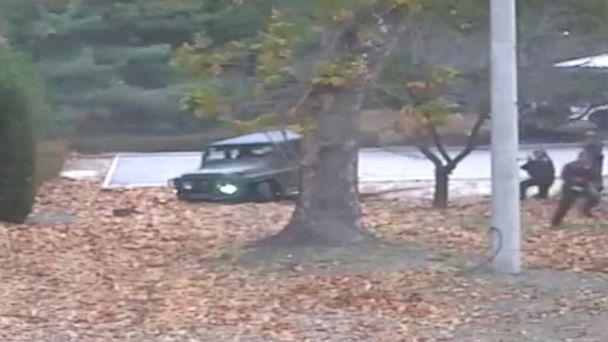 This image made from Nov. 13, 2017 surveillance video released by the United Nations Command shows a North Korean soldier running from a jeep and later shot by North Korean soldiers in Panmunjom, North Korea. (AP)