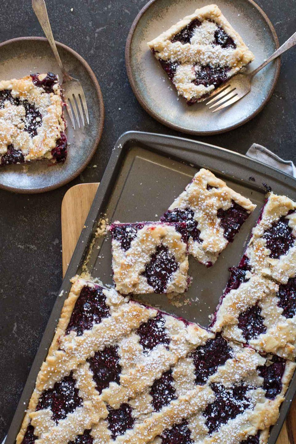 """<p>If the traditional deep-dish pie makes you nervous, try this slab pie instead. It's easy to bake in a jelly roll pan, and it feeds a crowd!</p><p><strong>Get the recipe at <a href=""""https://lovelylittlekitchen.com/triple-berry-slab-pie/"""" rel=""""nofollow noopener"""" target=""""_blank"""" data-ylk=""""slk:Lovely Little Kitchen"""" class=""""link rapid-noclick-resp"""">Lovely Little Kitchen</a>. </strong></p><p><a class=""""link rapid-noclick-resp"""" href=""""https://go.redirectingat.com?id=74968X1596630&url=https%3A%2F%2Fwww.walmart.com%2Fsearch%2F%3Fquery%3Djelly%2Broll%2Bpan&sref=https%3A%2F%2Fwww.thepioneerwoman.com%2Ffood-cooking%2Fmeals-menus%2Fg36558208%2Fsummer-pie-recipes%2F"""" rel=""""nofollow noopener"""" target=""""_blank"""" data-ylk=""""slk:SHOP JELLY ROLL PANS"""">SHOP JELLY ROLL PANS</a></p>"""