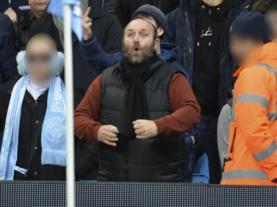 A Manchester City fan allegedly aimed a racial gesture at Manchester United players (EPA)